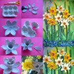 Composición de flores con hueveras recicladas